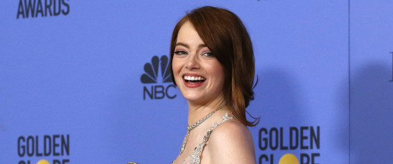 Emma Stone poses with her award during the 74th Annual Golden Globe Awards in Beverly Hills